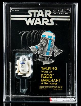 Lot # 74 - Canadian Carded Walking Wind-Up R2-D2 AFA 60 [Kazanjian Collection]