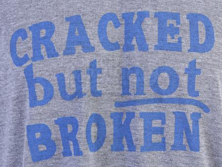 "Lot # 207 - S5E03 - ""Basic Intergluteal Numismatical"": Two ""Cracked But Not Broken"" T-Shirts"