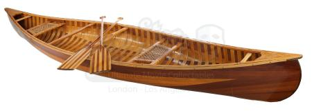 Lot # 11: FRIENDS - Joey Tribbiani and Chandler Bing's Wood Canoe and Two Paddles