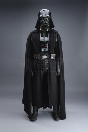 Lot #672 - STAR WARS: A NEW HOPE (1977) - 1977/1978 Darth Vader Promotional Costume With Poster-Matched Helmet