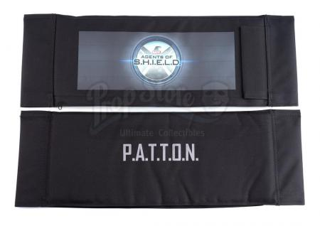 Lot #480 - Marvel's Agents of S.H.I.E.L.D. - Koenig Family 'P.A.T.T.O.N' Cast Member Chairback with Writer's Chairback